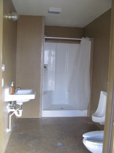 Three of the new bathrooms have showers and one has a bathtub/shower combination.  Our new ADA bathroom is very large with a huge shower that has no curb.  All of the new bathrooms have heat for the winter months.