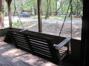 Watch the kids in the playground from the front porch from this swing.