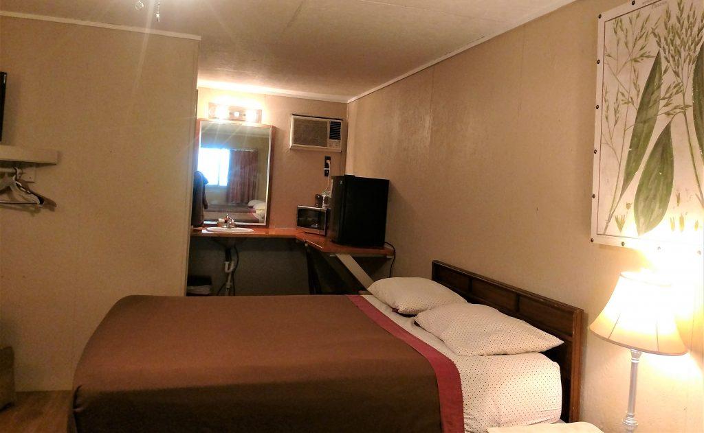 Bed, Sink, Microwave & Fridge in Hill Top Room