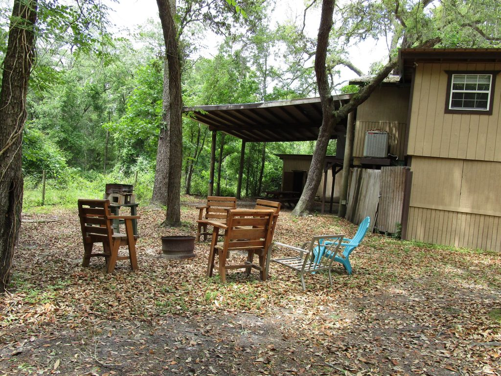 Chairs & Fire Pit Behind Tree House Cabin