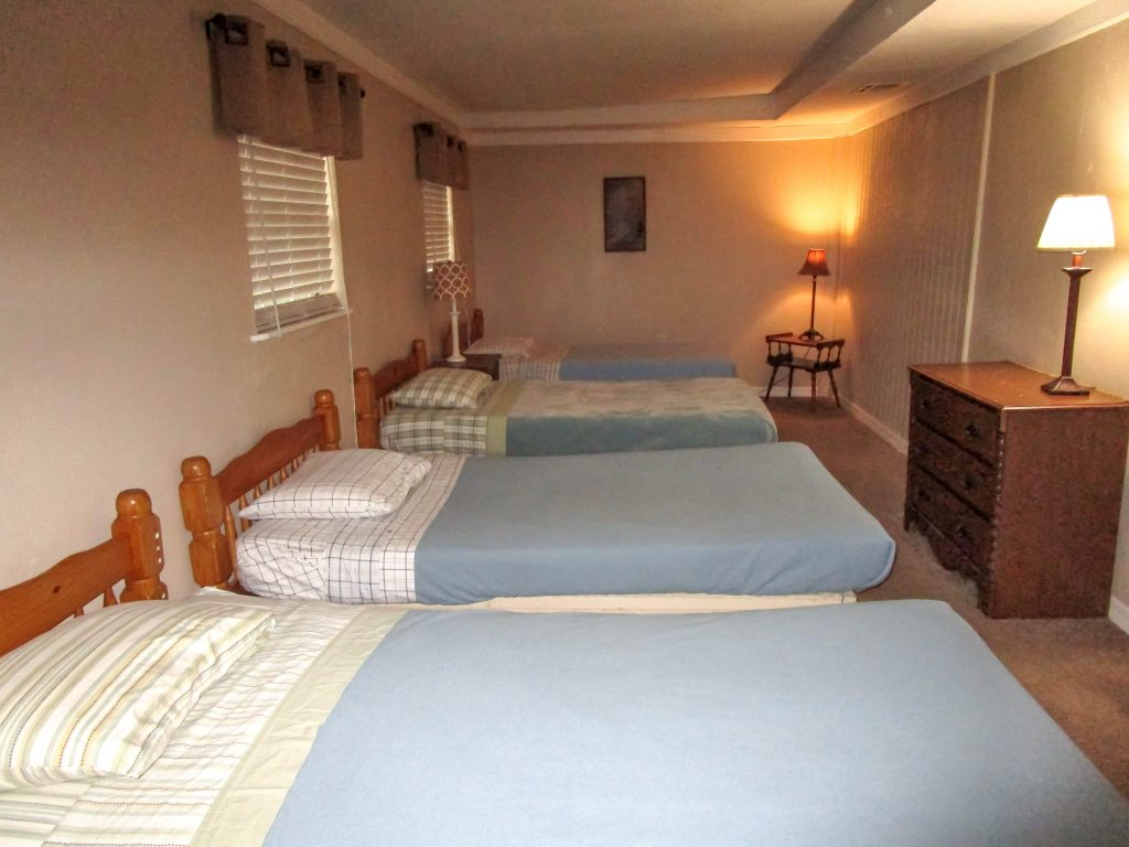 4 Twin Beds with Blue Blankets