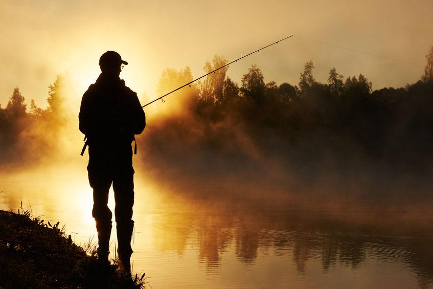Man Fishing Near Lake