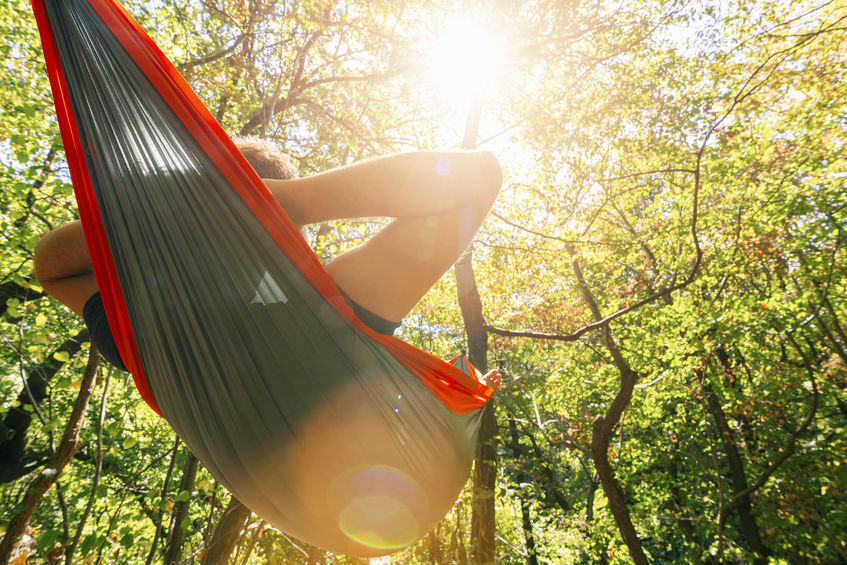 Man camping in a hammock